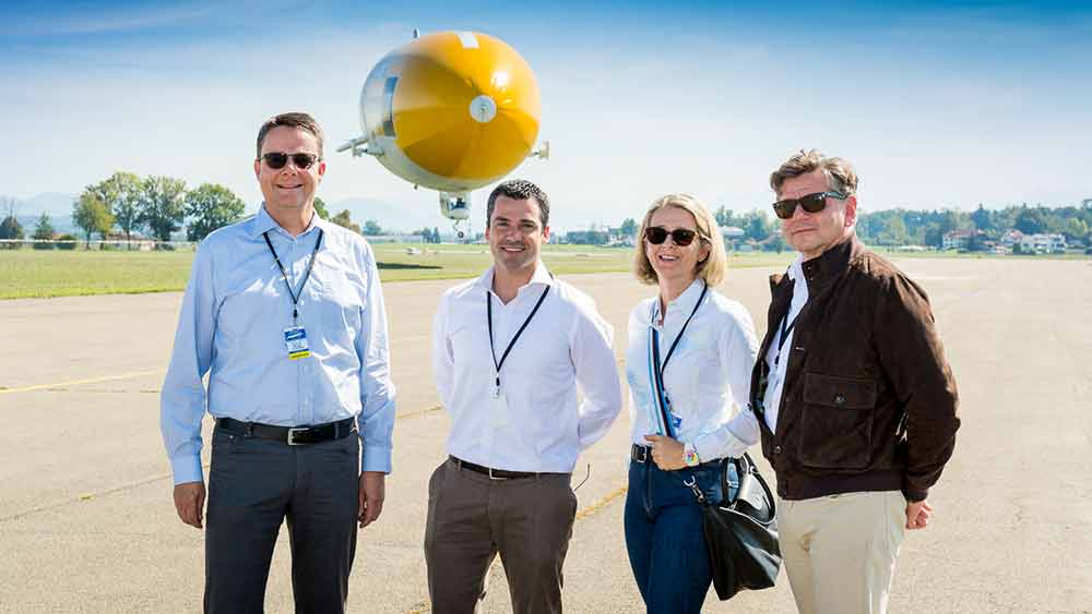 (From left) Michael Schaepman and Ruben Garcia Santos, Ursula Fricke, and Markus Reinhard of the NOMIS Foundation at Dübendorf airfield.