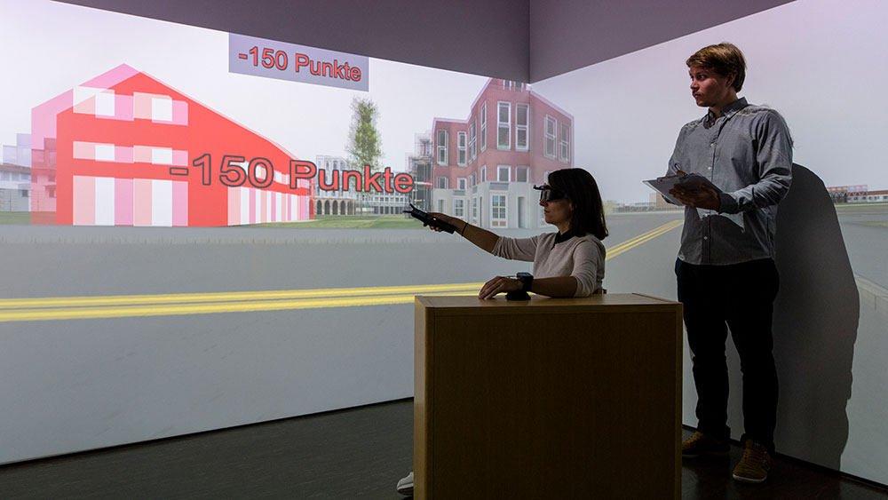 Sascha Credé (right) uses a virtual city to investigate the effects of stress on our sense of direction.