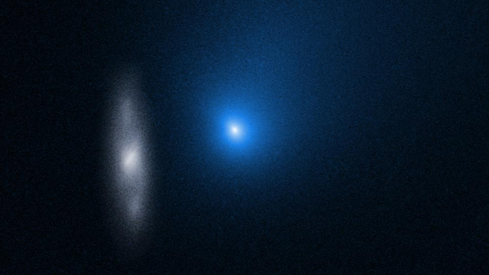 Comet Borisov in front of a distant background spiral galaxy imaged by the Hubble Space Telescope